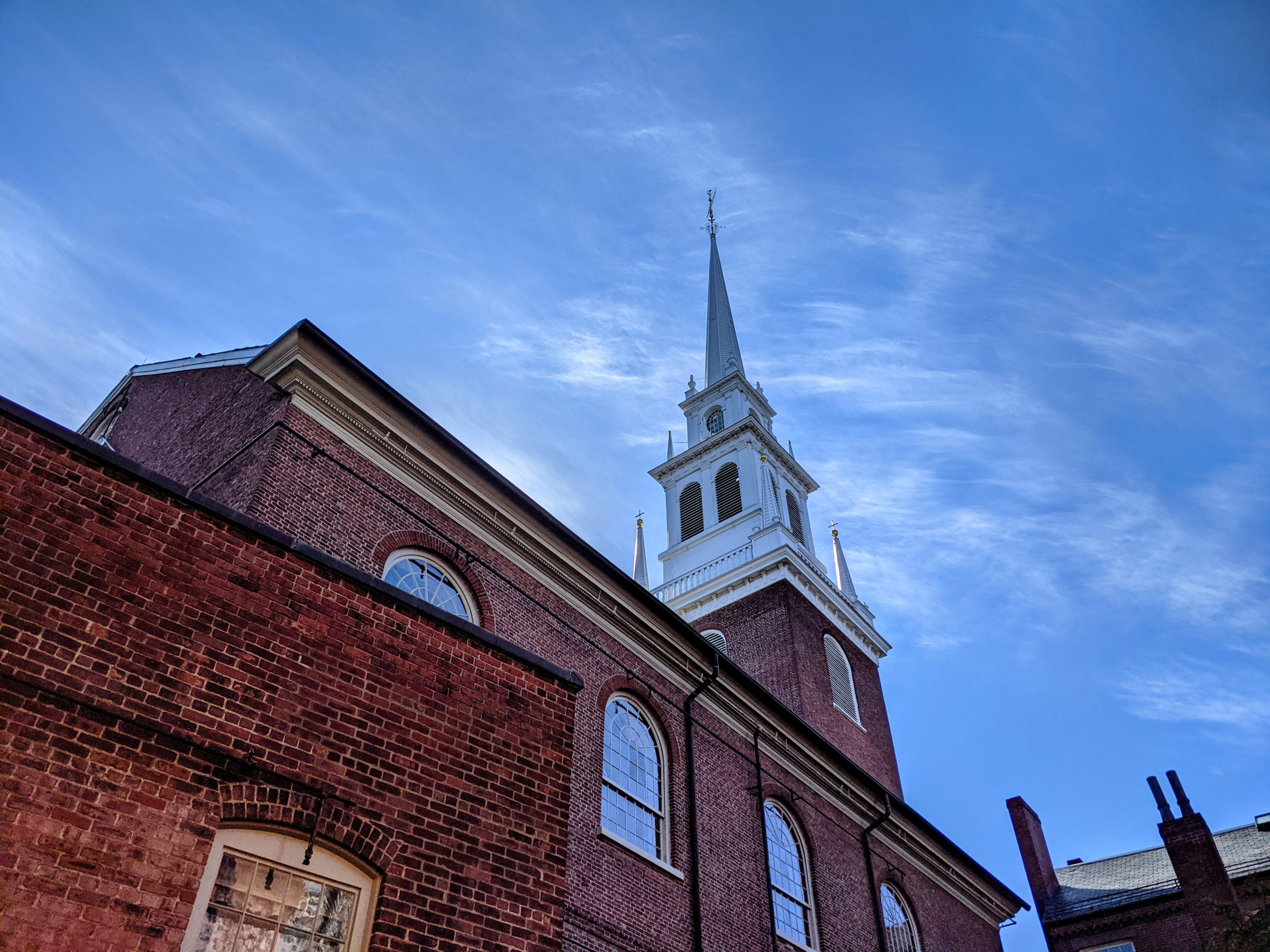 Old North's steeple against a blue sky.